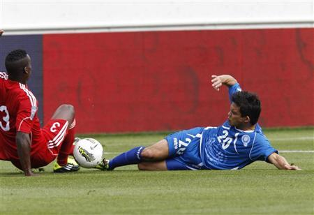 Andres Flores (R) of El Salvador fights for the ball with Yosmel De Armas of Cuba during their CONCACAF Olympic qualifying soccer match in Nashville, Tennessee March 24, 2012. REUTERS/Harrison McClary