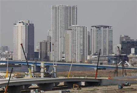 Newly-built high-rise apartments are seen through a construction site in Tokyo April 2, 2012. REUTERS/Yuriko Nakao