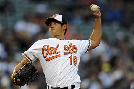 Baltimore Orioles' pitcher Wei-Yin Chen works the first inning against the New York Yankees during their MLB American League baseball game in Baltimore April 10, 2012. REUTERS/Patrick Smith