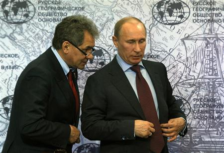 Russian Prime Minister and President-elect Vladimir Putin (R) speaks with recently elected Moscow Governor Sergei Shoygu during his visit to the Russian Geographical Society in St. Petersburg April 10, 2012. REUTERS/Alexander Demianchuk