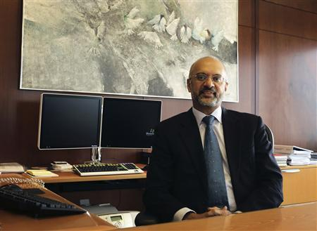 DBS Group CEO Piyush Gupta poses for a photo behind his desk at the bank headquarters in Singapore April 11, 2012. REUTERS/Tim Chong