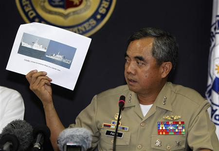 Philippine Navy flag officer-in-command vice admiral Alexander Pama presents to the media an undated file photo of a Chinese surveillance ship which blocked a Philippine Navy ship from arresting Chinese fishermen in Scarborough Shoal during a news conference at the Department of Foreign Affairs headquarters in Manila April 11, 2012. REUTERS/Romeo Ranoco