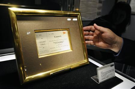 A launch ticket for the Titanic is put into a case at Bonham's auction house in New York April 10, 2012. REUTERS/Keith Bedford