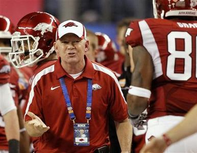 University of Arkansas head coach Bobby Petrino (C) reacts after wide receiver Jarius Wright (not pictured) scored a touchdown against Kansas State University during the first half of the Cotton Bowl Classic NCAA football game played at Cowboys Stadium in Arlington, Texas, in this January 6, 2012 file photo. REUTERS/Mike Stone/Files