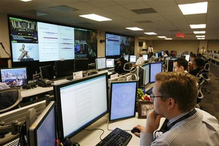 U.S. Department of Homeland Security analysts work at the National Cybersecurity & Communications Integration Center (NCCIC) located just outside Washington in Arlington, Virginia on September 24, 2010. REUTERS/Hyungwon Kang