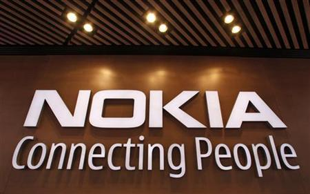 A corporate logo is displayed at the Nokia flagship store in Helsinki September 29, 2010. TREUTERS/Bob Strong