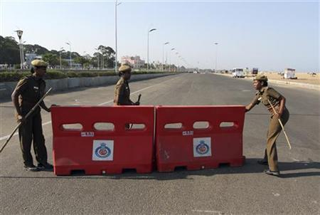 Police close the road near the Marina beach after a tsunami alert was issued in the southern Indian city of Chennai April 11, 2012, following an earthquake which struck off Indonesia. REUTERS/Babu