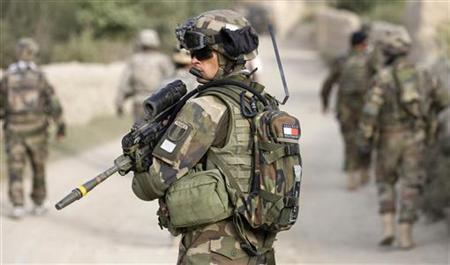 A French soldier of the NATO-led coalition secures the area during a joint patrol with U.S. and Afghan troops in the village of Hajian, in the mountains of Wardak Province in Afghanistan July 12, 2009. REUTERS/Shamil Zhumatov/Files