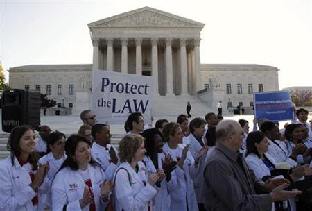 Medical students show their support for U.S. President Barack Obama's healthcare law during the first day of legal arguments over the Affordable Care Act at the Supreme Court in Washington March 26, 2012. REUTERS/Jason Reed