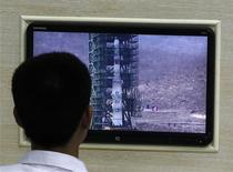 A North Korean scientist looks at a monitor showing the Unha-3 (Milky Way 3) rocket on a launch pad at the West Sea Satellite Launch Site, at the satellite control centre of the Korean Committee of Space Technology on the outskirts of Pyongyang April 11, 2012. REUTERS/Bobby Yip