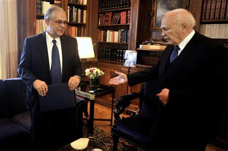 Greek Prime Minister Lucas Papademos (L) meets Greek President Karolos Papoulias in Athens April 11, 2012. REUTERS/Louisa Gouliamaki/Pool