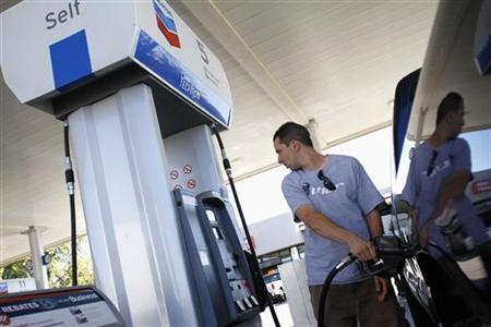 Kenny Sharrar pumps fuel into his truck at a Chevron gas station in Buckeye, Arizona October 27, 2011. REUTERS/Joshua Lott