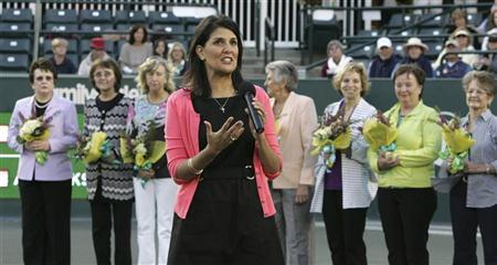 South Carolina Gov. Nikki Haley (front C) address the crowd as she recognizes the ''Original Nine'', founders of the women's professional tennis circuit, during a special presentation of the 40th anniversary of the women's professional tennis association at the Family Circle Cup tennis tournament in Charleston, South Carolina April 7, 2012. REUTERS/Mary Ann Chastain