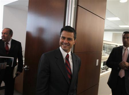 Mexico's presidential front-runner Enrique Pena Nieto smiles after an interview with Reuters in Mexico City April 9, 2012. REUTERS/Tomas Bravo