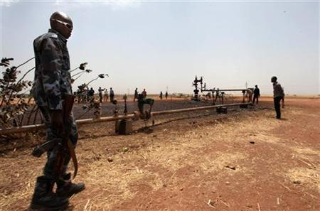 A South Sudan soldier walks at a ruptured oil well in South Sudan's Unity State, March 3, 2012. REUTERS/Hereward Holland