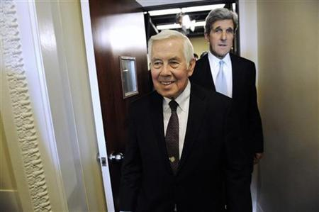 Senator Richard Lugar (R-IN) (C) and Senator John Kerry (D-MA) (R) walk out together after a news conference after the Senate ratified the START nuclear arms reduction treaty at the U.S. Capitol in Washington, December 22, 2010. REUTERS/Jonathan Ernst