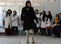 A disabled Afghan woman exercises with her prosthetic legs at the Orthopedic Center of the International Committee of the Red Cross in Kabul April 11, 2012. REUTERS/Omar Sobhani