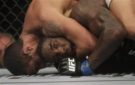 Vitor Belfort of Brazil (L) fights with Anthony Johnson of the U.S. during the Ultimate Fighting Championship (UFC) Rio, a professional mixed martial arts (MMA) competition, in Rio de Janeiro January 14, 2012. REUTERS/Ricardo Moraes