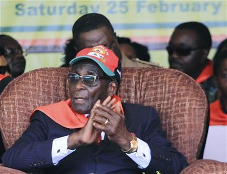 Zimbabwe President Robert Mugabe listens to speeches during his 88th birthday rally in Mutare about 265km (165miles) east of the capital Harare, February 25, 2012. REUTERS/Philimon Bulawayo/Files