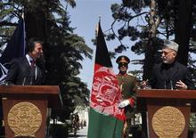 Afghanistan's President Hamid Karzai (R) talks as NATO Secretary General Anders Fogh Rasmussen (L) looks on during a joint news conference in Kabul April 12, 2012. REUTERS/Stringer
