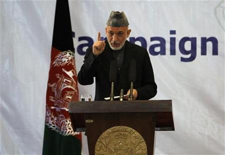 Afghan President Hamid Karzai speaks during a ceremony to mark the start of the school year in Kabul March 24, 2012. REUTERS/Omar Sobhani/Files