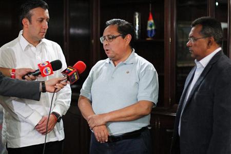 Venezuela's Interior Minister Tarek El Aissami (L) listens to freed abduction victim Guillermo Cholele (C), a Costa Rican diplomat, at the Costa Rican Embassy in Caracas April 10, 2012. REUTERS/MPPRIJ/Handout