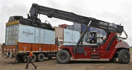 A container is unloaded from a truck at Thar Dry Port in Sanand in Gujarat September 1, 2011. REUTERS/Amit Dave/Files
