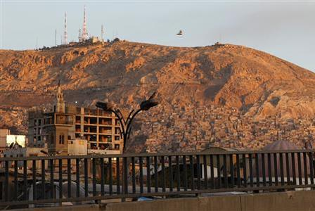 A general view of Damascus city during sunrise April 12, 2012. REUTERS/Khaled al-Hariri