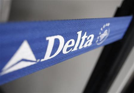 The Delta airline logo is seen on a strap at JFK Airport in New York, July 30, 2008. Delta Air Lines Inc on Wednesday announced a award travel structure for its Skymiles frequent flier program. REUTERS/Joshua Lott
