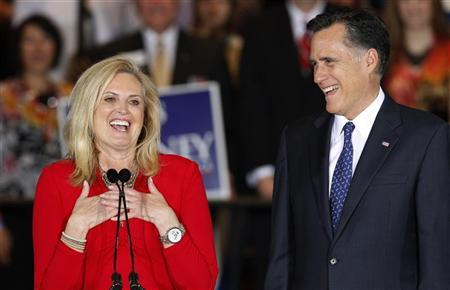 U.S. Republican presidential candidate Mitt Romney and his wife, Ann react while onstage during his Illinois primary night rally in Schaumburg, Illinois, March 20, 2012. REUTERS/Jeff Haynes