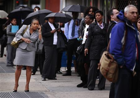 A woman talks on the telephone as she stands in a line of job seekers waiting to attend the Dr. Martin Luther King Jr. career fair held by the New York State department of Labor in New York, April 12, 2012. A report on Friday showed the economy created only 120,000 jobs last month, the fewest since October. REUTERS/Lucas Jackson