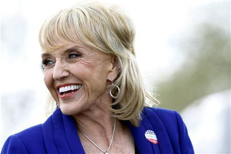 Arizona Governor Jan Brewer talks to reporters after voting for Republican presidential candidate and former Massachusetts Governor Mitt Romney in Glendale, Arizona February 28, 2012. REUTERS/Joshua Lott