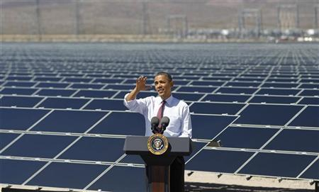 U.S. President Barack Obama delivers remarks on clean energy as he visits the Copper Mountain Solar Project in Boulder City, Nevada, March 21, 2012. Obama is traveling to Nevada, New Mexico, Oklahoma and Ohio for events on his energy initiative. REUTERS/Jason Reed