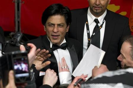 Cast member Shah Rukh Khan arrives for the screening of the movie ''Don - The King is back'' at the 62nd Berlinale International Film Festival in Berlin February 11, 2012. REUTERS/Thomas Peter/Files