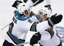 San Jose Sharks right wing Martin Havlat (L) celebrates his game winning double-overtime goal against the St. Louis Blues with his teammate Dan Boyle during their NHL Western Conference quarterfinal playoff hockey game in St. Louis, Missouri April 12, 2012. REUTERS/Sarah Conard