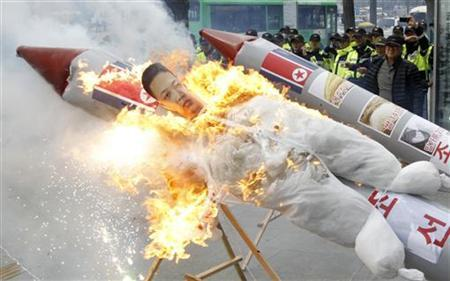 Protesters from conservative, right-wing and anti-North Korean civic groups burn an effigy of North Korean leader Kim Jong-Un bound on a mock North Korean missile during a protest against North Korea's rocket launch near the U.S. embassy in Seoul April 13, 2012. REUTERS/Lee Jae-Won