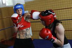 Spanish boxers Jennifer Miranda (L) and Marta Branas do some sparring during a training session at a high-performance sports centre in Los Alcazares, southeastern Spain, April 3, 2012. REUTERS/Susana Vera