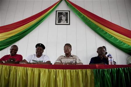 Guinea Bissau's ruling party presidential candidate Carlos Gomes Junior (C) waits to speak to supporters at his party's headquarters in the capital Bissau, March 21, 2012. REUTERS/Joe Penney
