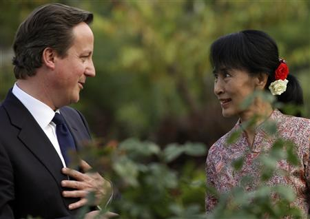Britain's Prime Minister David Cameron chats with Nobel laureate and newly elected parliamentarian Aung San Suu Kyi at her residence in Yangon April 13, 2012. REUTERS/Damir Sagolj