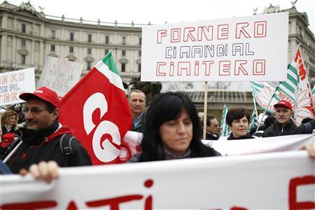 Protesters hold a placard during a protest against the Italian government in downtown Rome April 13, 2012. REUTERS/Tony Gentile