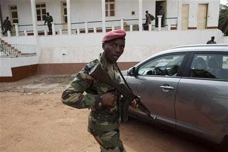A Guinea Bissau soldier holds his gun at the military headquarters in the capital Bissau, March 19, 2012. REUTERS/Joe Penney