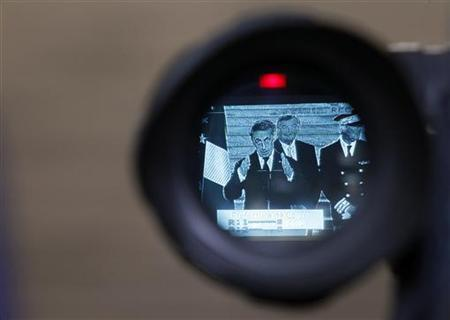 France's President Nicolas Sarkozy is seen on a camera screen during a news conference at the Corsica Prefecture in Ajaccio on the French Mediterranean island of Corsica April 13, 2012. REUTERS/Jean-Paul Pelissier