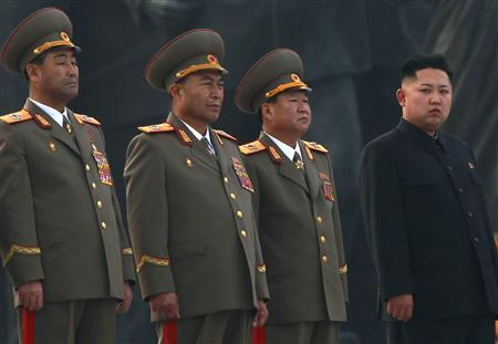 Kim Jong-un (R), current leader of North Korea, stands with military officers during the unveiling ceremony of bronze statues of North Korea founder Kim Il-sung and late leader Kim Jong-il in Pyongyang April 13, 2012. REUTERS/Bobby Yip