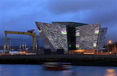 The Titanic centre in Belfast is illuminated by digital projections as part of the city's festival of events to commemorate the 100th anniversary of Titanic's fateful maiden voyage, April 7, 2012. REUTERS/Cathal McNaughton