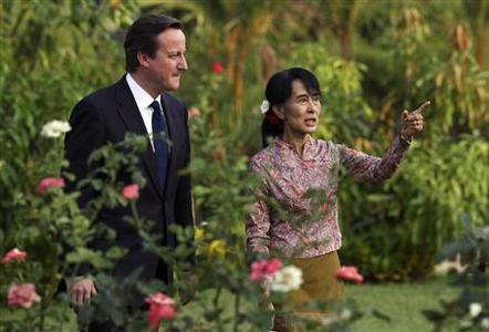 Britain's Prime Minister David Cameron (L) listens to Nobel laureate and newly elected parliamentarian Aung San Suu Kyi at her residence in Yangon April 13, 2012. REUTERS/Damir Sagolj