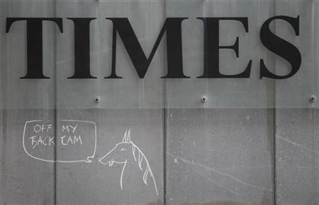 Graffiti refering to a retired police horse which was lent to former News International executive Rebekah Brooks and which British Prime Minister David Cameron admitted to riding, is seen outside the headquarters of the Times newspaper in London's east end, March 13, 2012. REUTERS/Andrew Winning