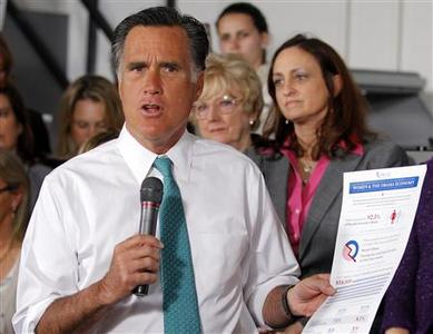 Republican presidential candidate and former Massachusetts Governor Mitt Romney holds a campaign brochure criticizing U.S. President Barack Obama's record on women in the workforce during a campaign stop at Alpha Graphics in Hartford, Connecticut April 11, 2012. REUTERS/Brian Snyder