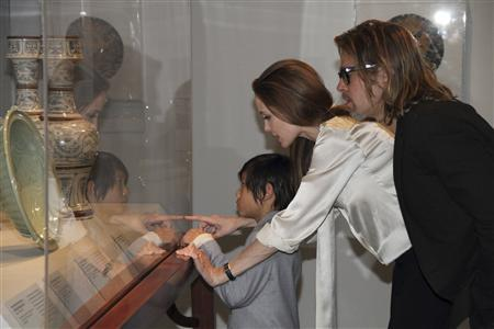 Art patrons and supporters, Angelina Jolie (C), Brad Pitt (R), and their son Pax view works from the Los Angeles County Museum of Art's Chinese collection on April 11 in this publicity handout photograph provided to Reuters April 13, 2012. REUTERS/Howard Pasamanick/(C) 2012 Museum Associates/LACMA/PRNewsFoto/The Los Angeles County Museum of Art (LACMA)/Handout