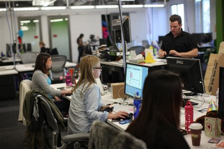 Facebook employees work in the design studio at the company's headquarters in Menlo Park, California March 2, 2012. REUTERS/Robert Galbraith