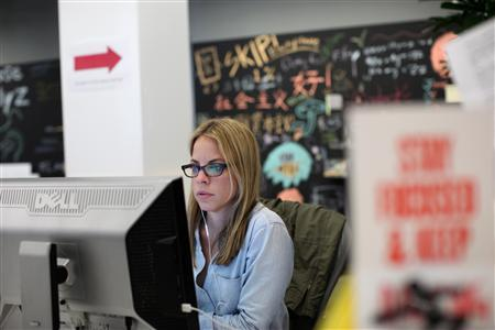 A Facebook employee works in the design studio at the company's headquarters in Menlo Park, California March 2, 2012. REUTERS/Robert Galbraith